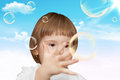 The small girl plays with soap bubbles Royalty Free Stock Photography