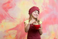 Small girl in red chef hat, apron with chocolate cookies Royalty Free Stock Photo