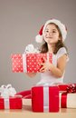 Small girl in santa hat with christmas gift happy Stock Images