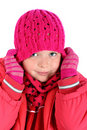 Small girl stretching her winter cap over white Stock Photography