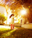 Small girl in sunny autumn day Royalty Free Stock Photo