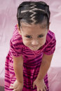 Small girl with teasing smile Stock Photo