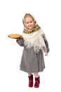 A small girl in traditional russian kerchief holding a plate of pancakes isolated on white background Royalty Free Stock Image