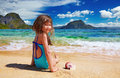 Small girl on the tropical beach sitting sand el nido philippines Royalty Free Stock Images