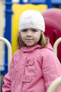 Small girl wearing a pink coat smiling Royalty Free Stock Photos