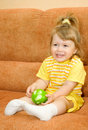 Small girl in yellow eat green apple Royalty Free Stock Photo