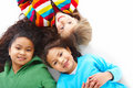 Small girls lying down in a circle over white b Stock Images