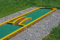 Small golf course built for children in a recreational space Stock Photos