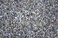 Small gray river stones background, simplicity texture in daylight, group of color stones