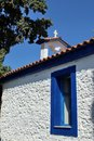 Small greek church between cypresses Royalty Free Stock Photo