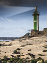 Small green lighthouse in france atlantic ocean Royalty Free Stock Photo