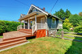 Small grey house with back porch and old fence. Royalty Free Stock Photo
