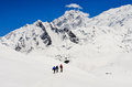 Small group of mountain trekkers in high winter himalayas mounta mountains nepal Royalty Free Stock Photo