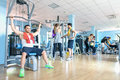 Small group of sportive friends at gym fitness club center Royalty Free Stock Photo