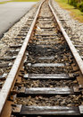 Small guage tracks into curve old narrow gauge railroad distance Royalty Free Stock Images