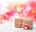 Small handmade gift boxes in pink hearts background Stock Photography