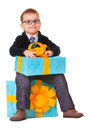 Small happy boy in spectecles with big present Royalty Free Stock Photo