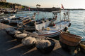 Small harbor in lebanon fishing nets and boats at the of byblos at sunset Stock Image