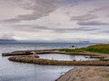 Small harbor of a remote village in iceland the hofsos Royalty Free Stock Images