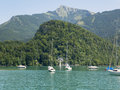 Small harbor in Wolfgangsee mountain lake. Anchored yachts, sunny weather. Royalty Free Stock Photo