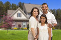 Small hispanic family in front of their home happy mother father and daughter Royalty Free Stock Photos