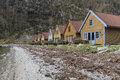 Small holiday homes at coastline in norway Stock Photography