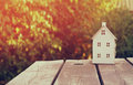 Small house model over wooden table outdoors at garden . filtered image. selective focus Royalty Free Stock Photo
