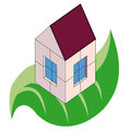 Small house over green leaf Stock Photography