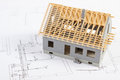 Small house under construction on electrical drawings, concept of building home Royalty Free Stock Photo