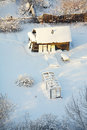 Small house under snow Stock Photos