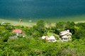 Small houses near lagoon brazil Stock Photo