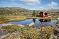 Small hut at norwegian lake Stock Photography