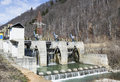 Small hydro electric dam harnessing water power in a mountain area Stock Image