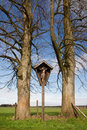 Small inri cross between two trees Royalty Free Stock Images
