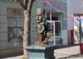 Small iron cast netsuke statuette decorating the center of Mukachevo town photo, Ukraine on May 1, 2017. Royalty Free Stock Photo