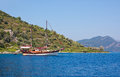 Small island of the aegean sea ship costs at coast one islands marmaris turkey Stock Photos