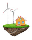 Small island with house and wind turbine Royalty Free Stock Photo