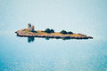 Small island with a lighthouse in the adriatic sea croatia Stock Photography
