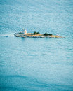 Small island with a lighthouse in the adriatic sea croatia Royalty Free Stock Images