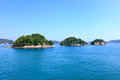 Small islands on sea and blue sky. Toba bay, Japan. Royalty Free Stock Photography