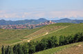 Small italian town among green hills and vineyards of piedmont view with roddi on background at spring in northern italy Royalty Free Stock Image