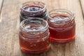 Small jam jar on wood table Royalty Free Stock Photo
