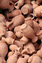 Small jars of clay some terracotta portrait cut Stock Photos