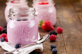 Small jars with homemade yogurt with berries Royalty Free Stock Photos