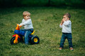Small kids brothers driving bicycle Royalty Free Stock Photo