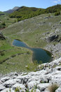 Small lake in mountain Stock Photo