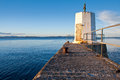 Small lighthouse and pier Stock Photography