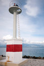 Small lighthouse in the port of corfu greece Stock Photography