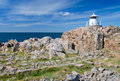 Small lighthouse on the top of kullen peninsula specific sea coast lanscape with white in western sweden Stock Photos
