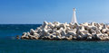 Small lighthouse  in Zygi Marina. Cyprus. Royalty Free Stock Photo